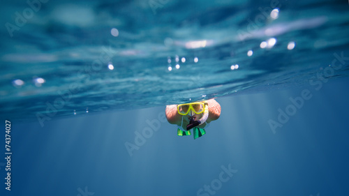 Underwater portrait of a woman snorkeling - 74374027