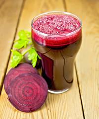 Juice beet in glass on board