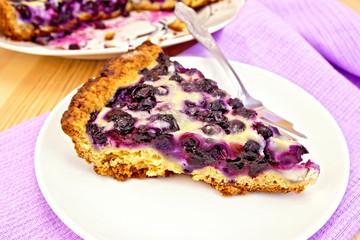 Pie blueberry in plate on board