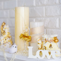 Still life with wooden love letters and decoration candles