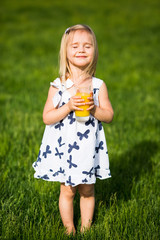 Beautiful little girl and juice