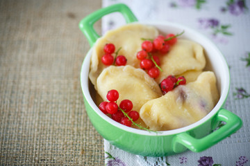 sweet dumplings with cheese and berries