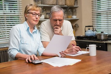 Senior couple working out their bills