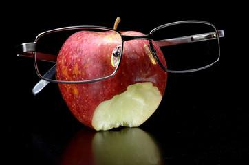 Eaten apple with glasses