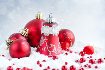 Christmas red balls on snow on festive background