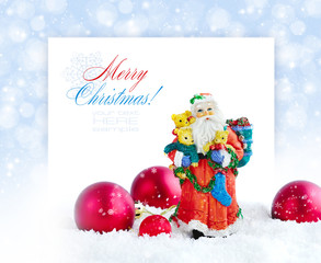 Santa Claus with Christmas decorations on a festive background