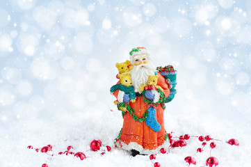 Santa Claus with Christmas decorations on snow