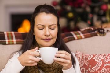 Pretty brunette enjoying hot chocolate