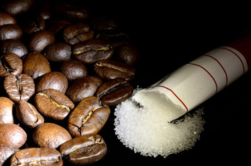 Coffee beans and poured sugar