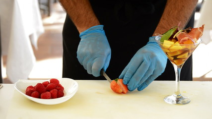 Professional chef hands decorating a cocktail