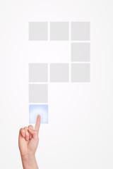Hand pressing touchscreen question mark