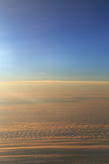 Blue sky over the surface of orange clouds, aerial photography