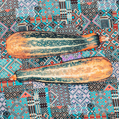 glamorous zucchini on the fabric ornament background
