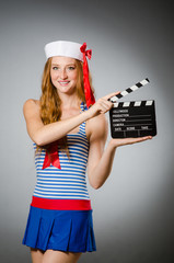 Young woman sailor with movie board