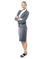 Smiling business woman, folded arms.
