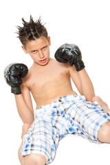 boy with black boxing gloves isolated on white