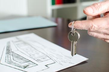Estate agent showing house keys