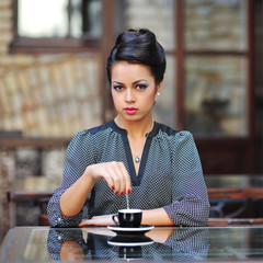 Woman with a cup of coffee at the cafe