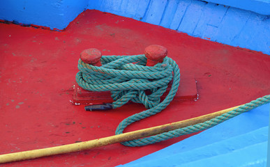 Mooring node closeup on wooden deck of a boat