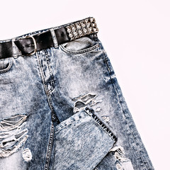 Stylish vintage blue jeans with metal strap. Rock style