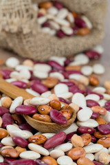 various beans on wooden surface