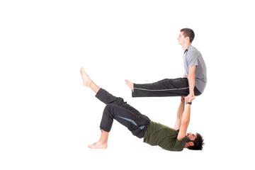 Men in Acro Yoga pose