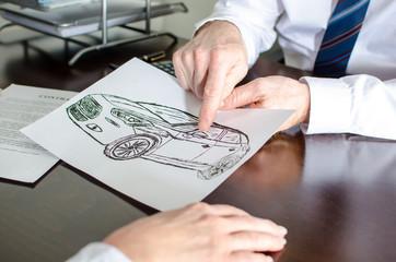 Dealer showing a detail on a car design