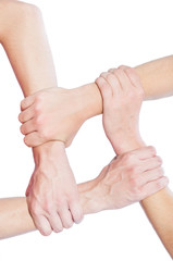 Team concept using joined hands.