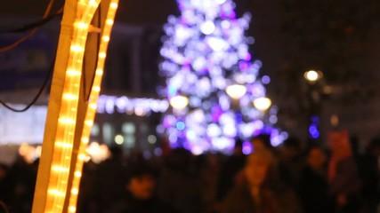 xmas city lights with tree blured