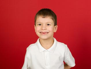 grimacing boy portrait on red