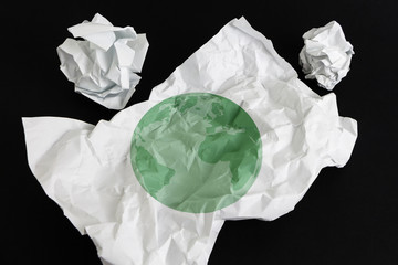 Crumpled paper sheet with Earth illustrated on it, isolated