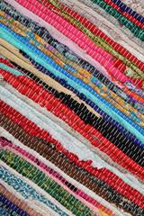 Recycling, handmade colorful ethnic motley retro rug, carpet