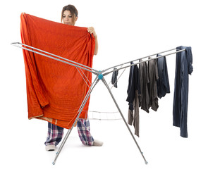 Happy housewife hanging clothes to dry isolated on white.