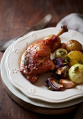 Oven-roasted duck legs and vegetables (autumn style)