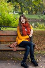 Girl on bench in autumn park