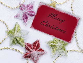 Red Christmas card on white snow  background.