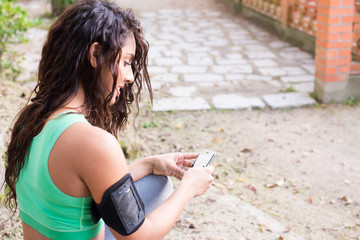 Fitness woman using phone