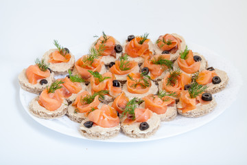 party platter with sandwiches with salmon