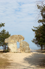 The stone monument standing at the seashore in Latvia