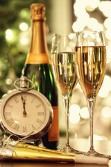 Glasses of champagne with festive background