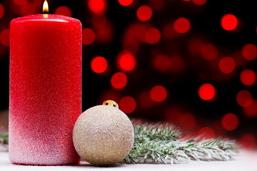 two candles on the background of beautiful bokeh