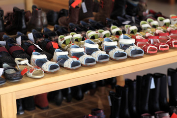 Children's summer shoes on the shelf