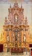Seville - marble side altar in church Iglesia del Sagrario.