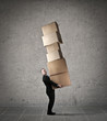 Businessman carrying boxes