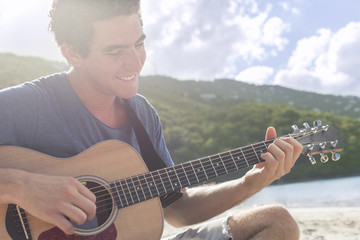 Young men playing guitar