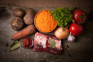 Ingredients for Turkey vegetable soup with red lentils, lying on