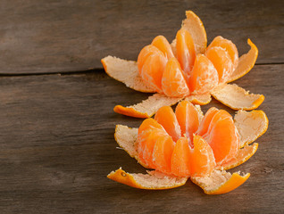 two orange mandarin on the wooden background