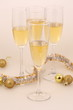 Still-life with wine glasses, gold spheres and a tinsel