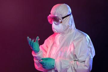 Scientist in Hazmat Suit Holding Petri Dish
