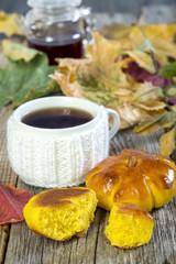 Tea with pumpkin buns.